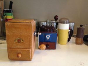 Coffee grinders from 1920, 1940, 1960 and 2010